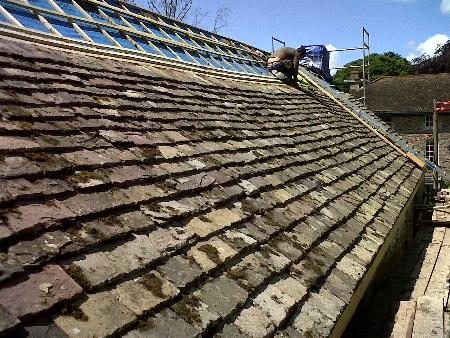traditional stone tile roof on one of our barn conversions